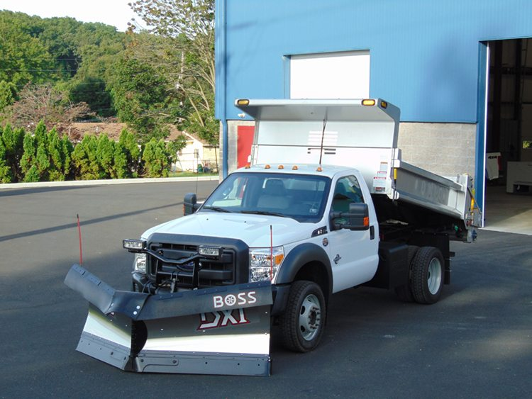 White truck with large plow and dump