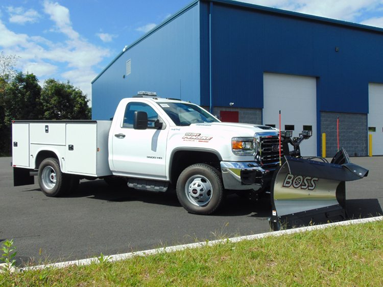 White work truck in front of warehouse