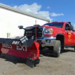 Boss brand snow plow on red truck
