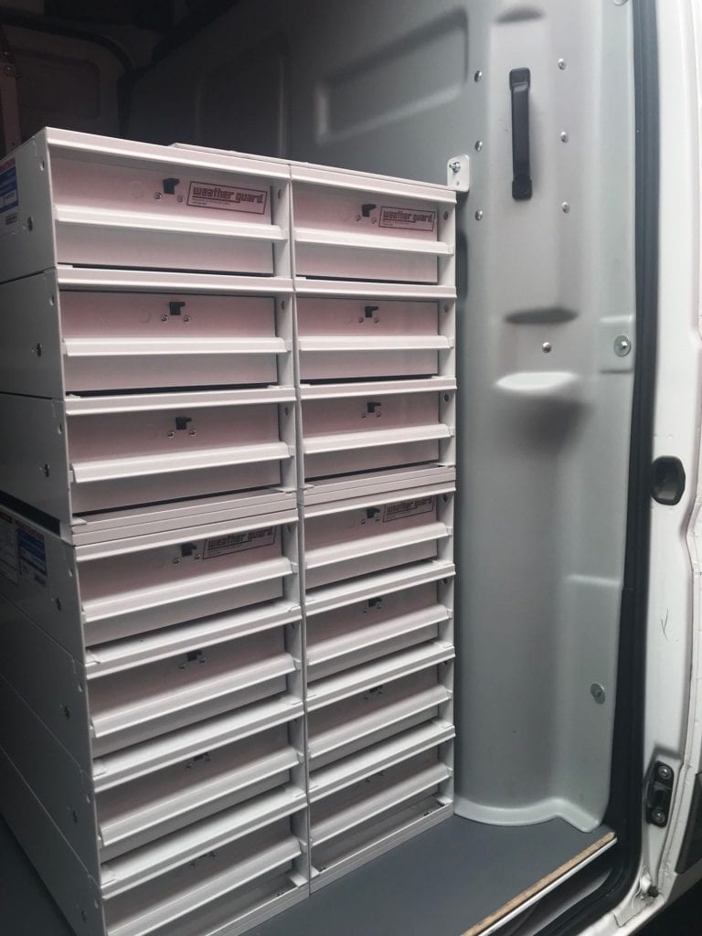stacked storage compartments in work van