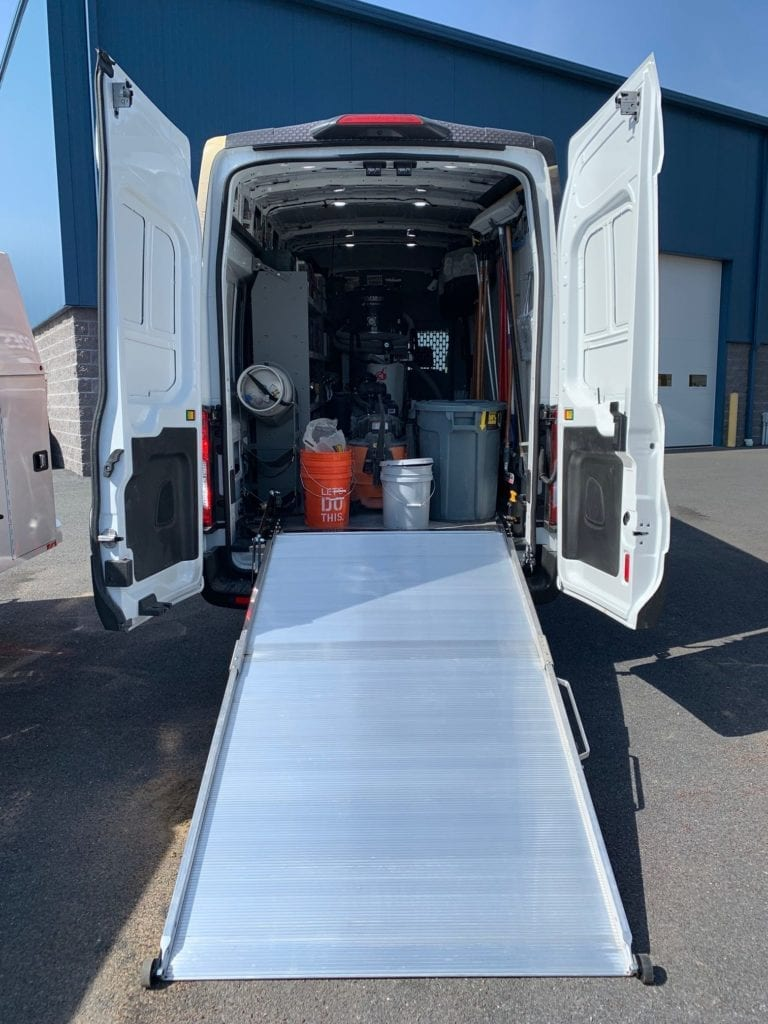 ramp leading into the back of a loaded work van