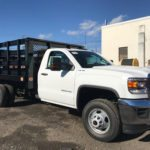 White truck with large work bed
