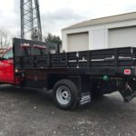 red flatbed truck at garage