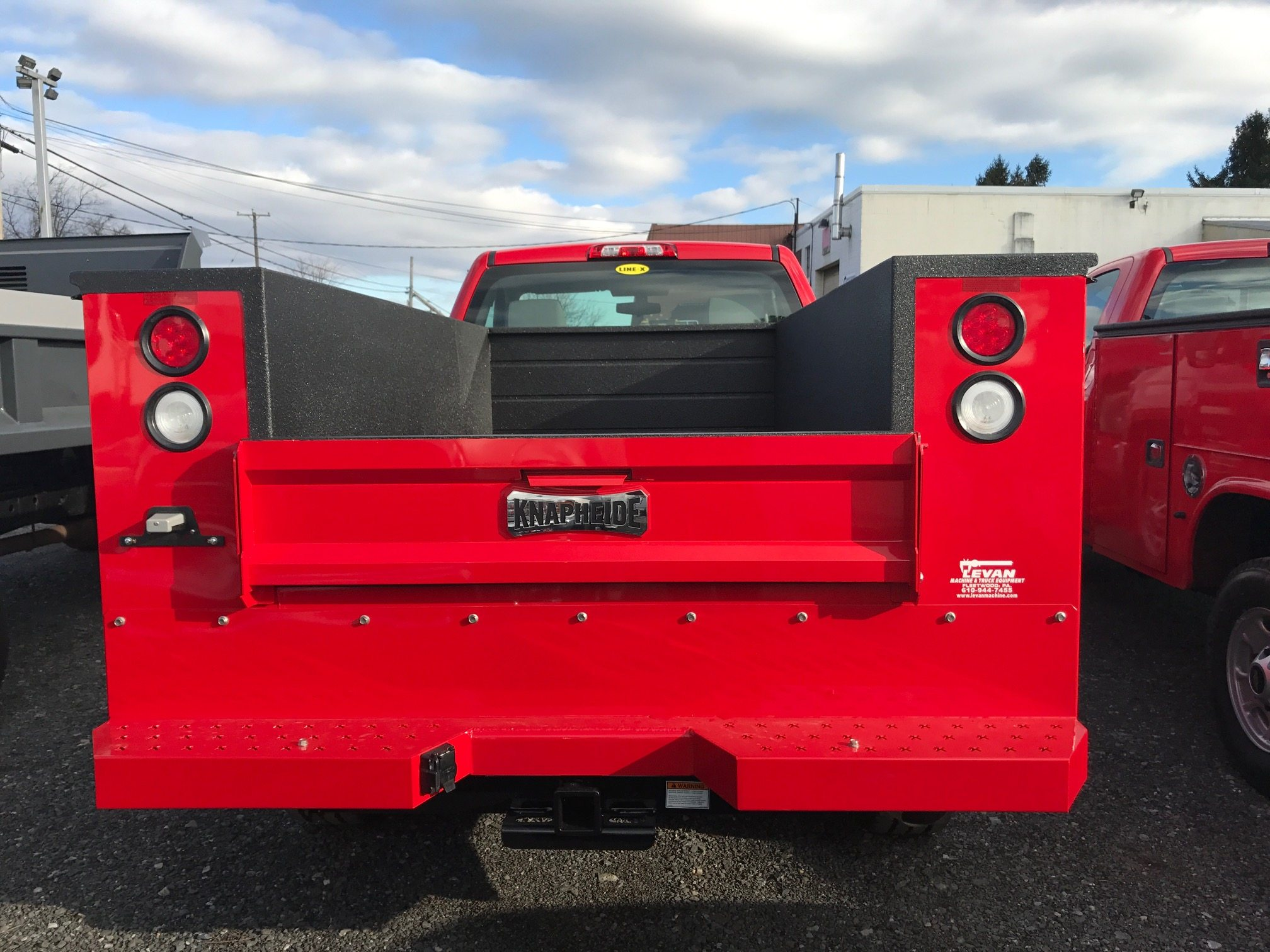 Red utility truck rear
