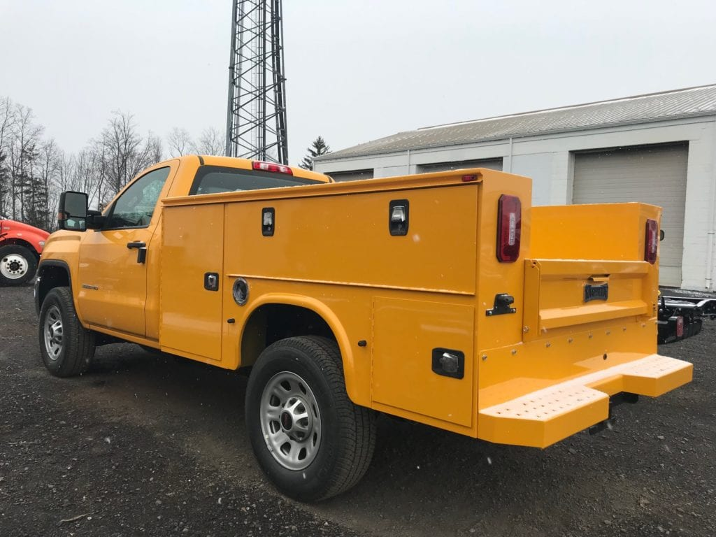 back of parked yellow work truck