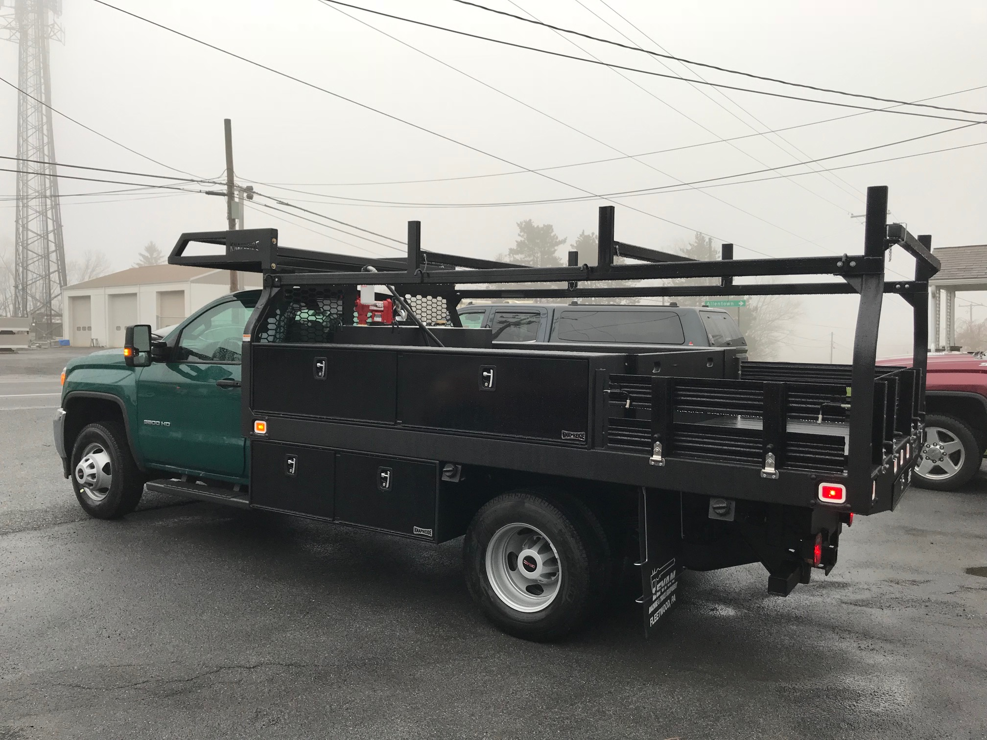 side of green and black truck