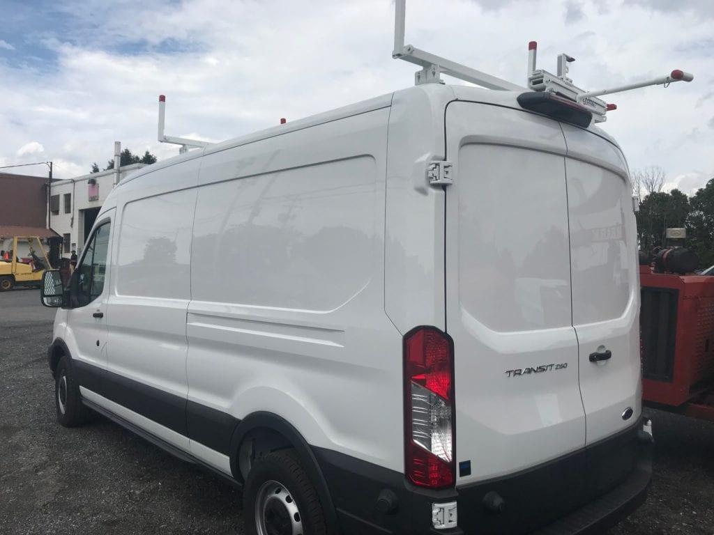 exterior of white transit work van