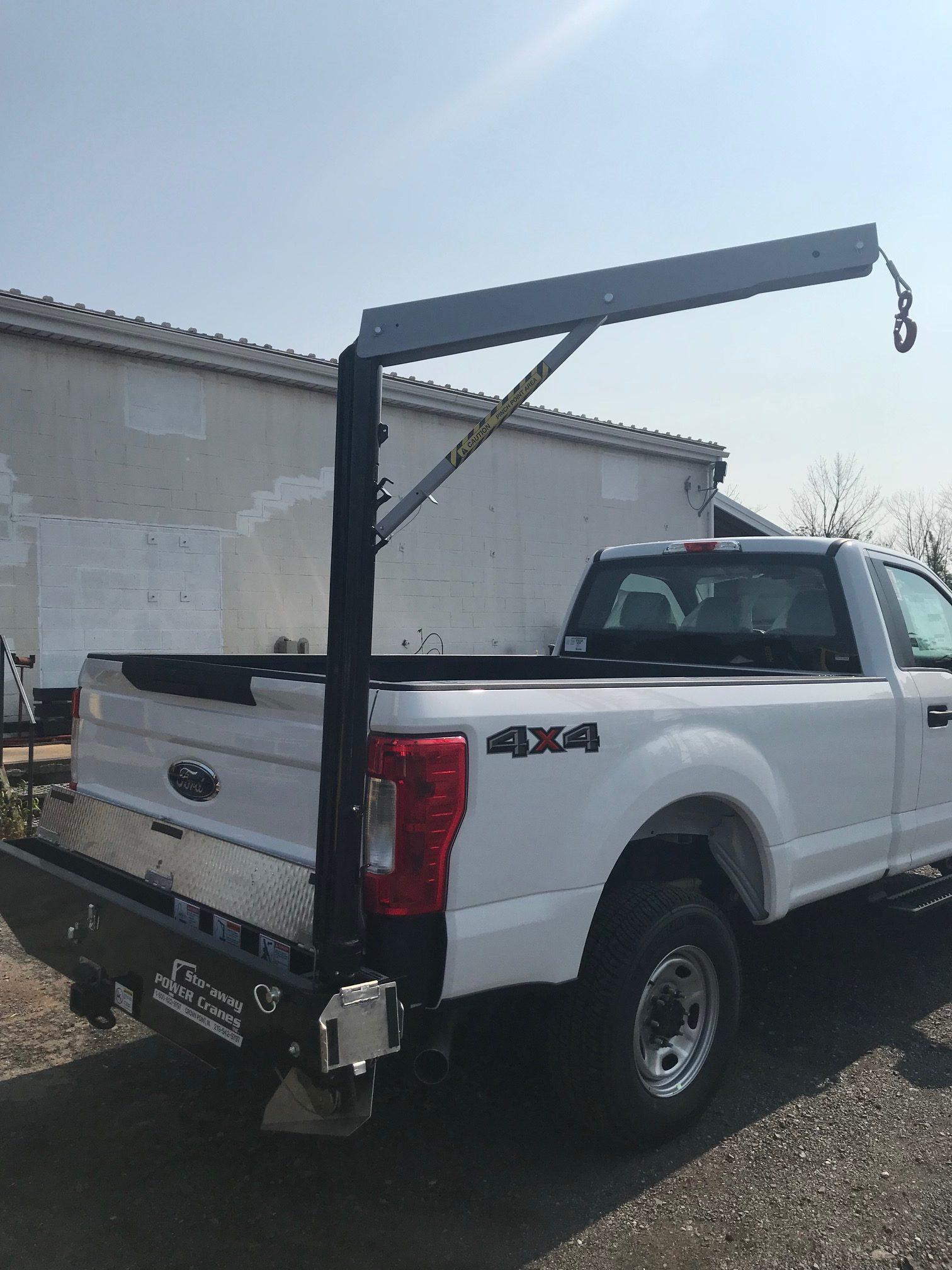 back of white crane pickup truck