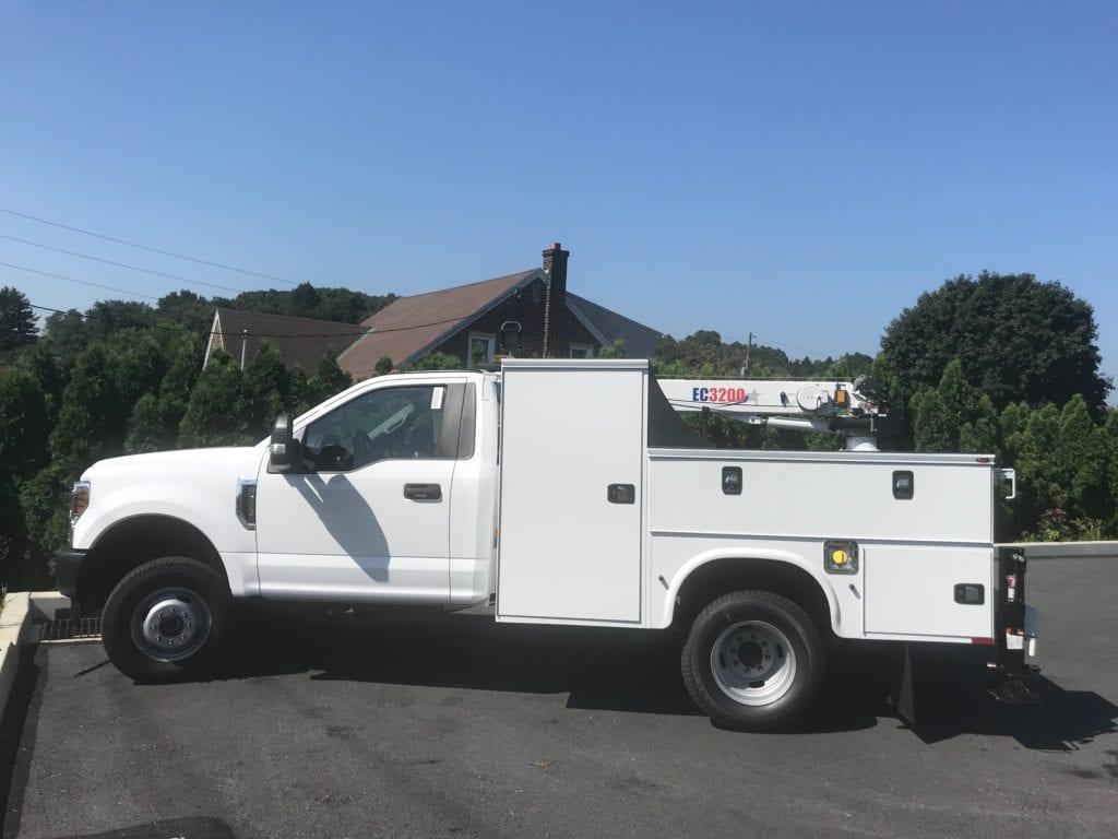 side of white crane truck