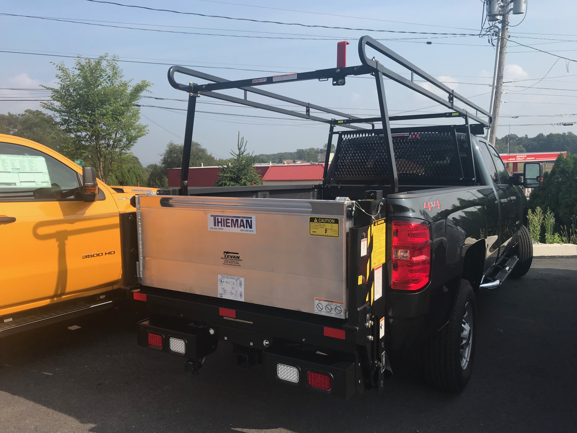 truck bed of black pickup truck parked on pavement