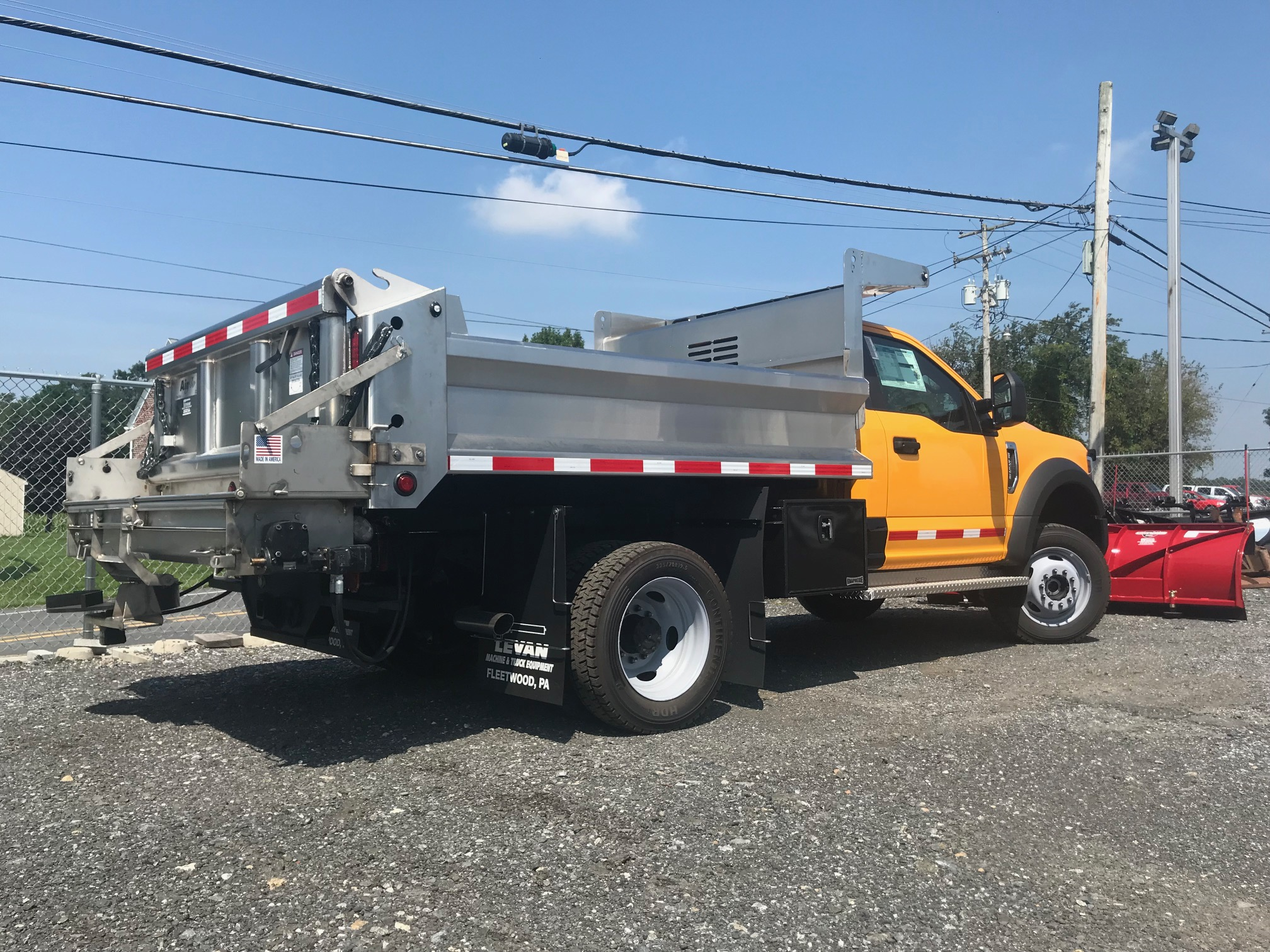 back of yellow and silver dump truck