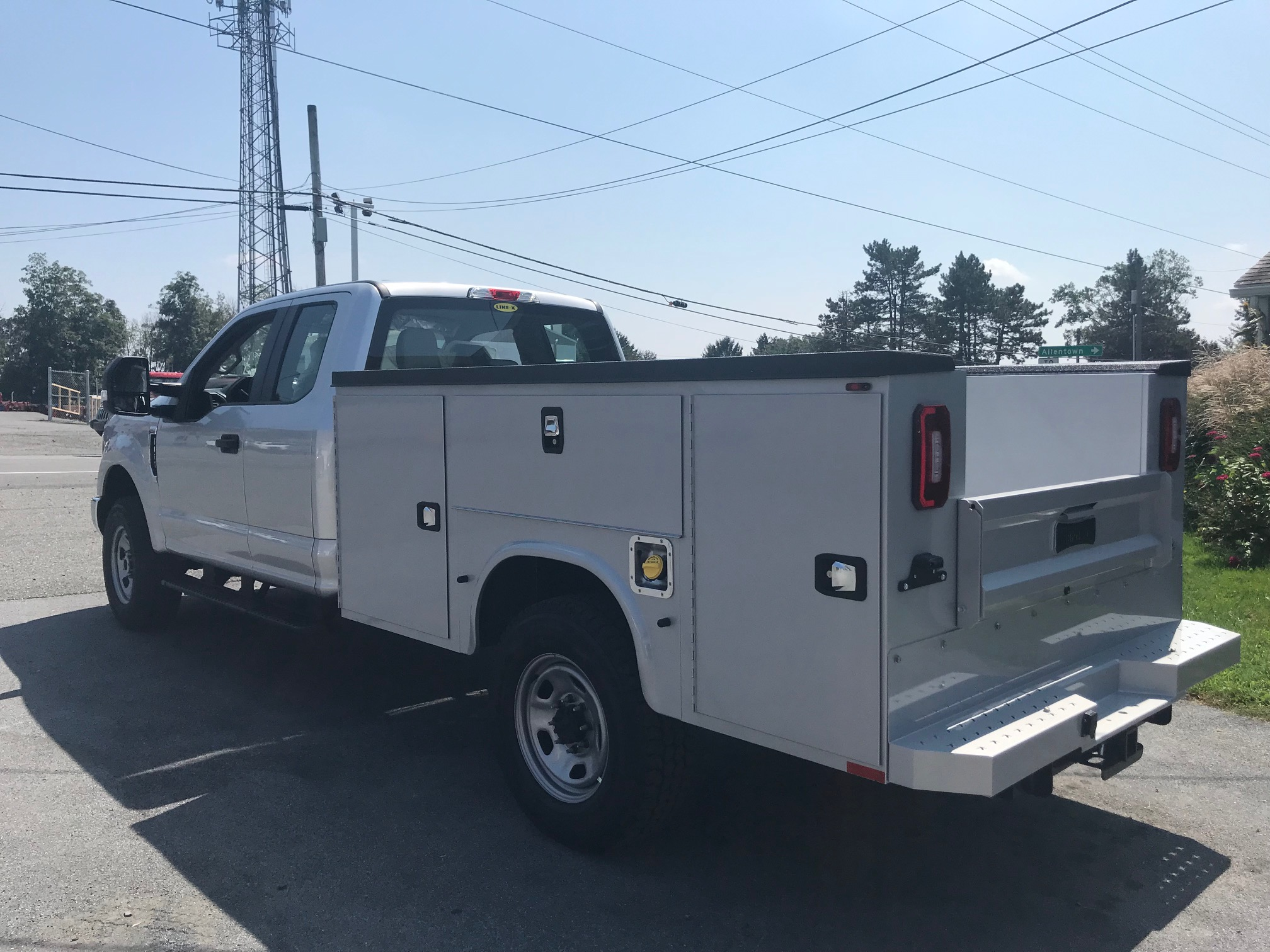 back of parked white work truck