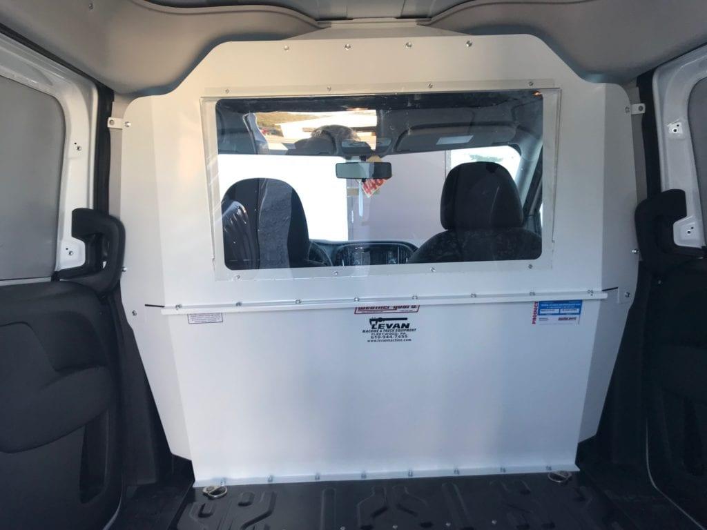 rear work van window looking into cabin
