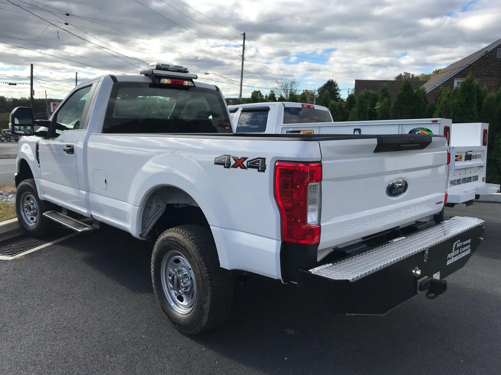 back of white pickup truck