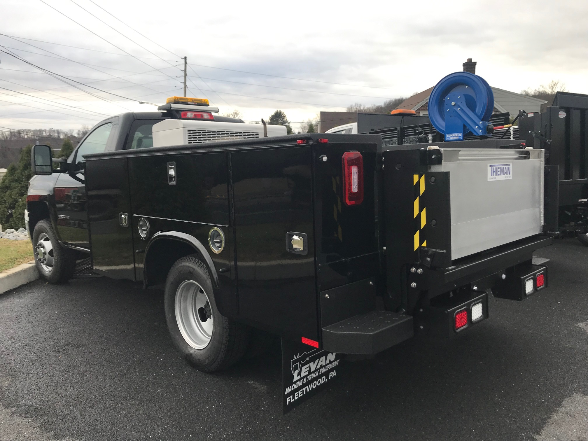 back of parked black work truck