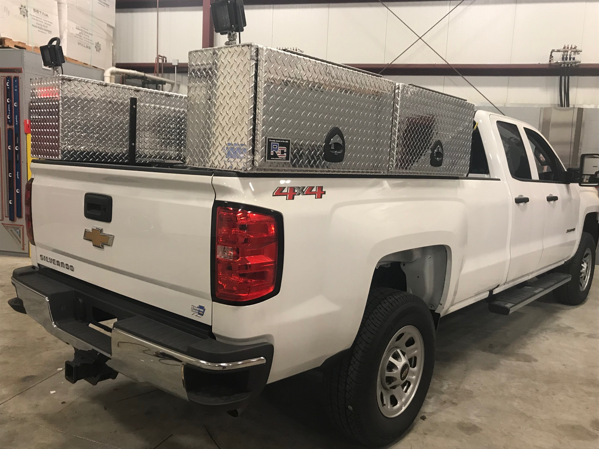storage on the back of white pickup truck
