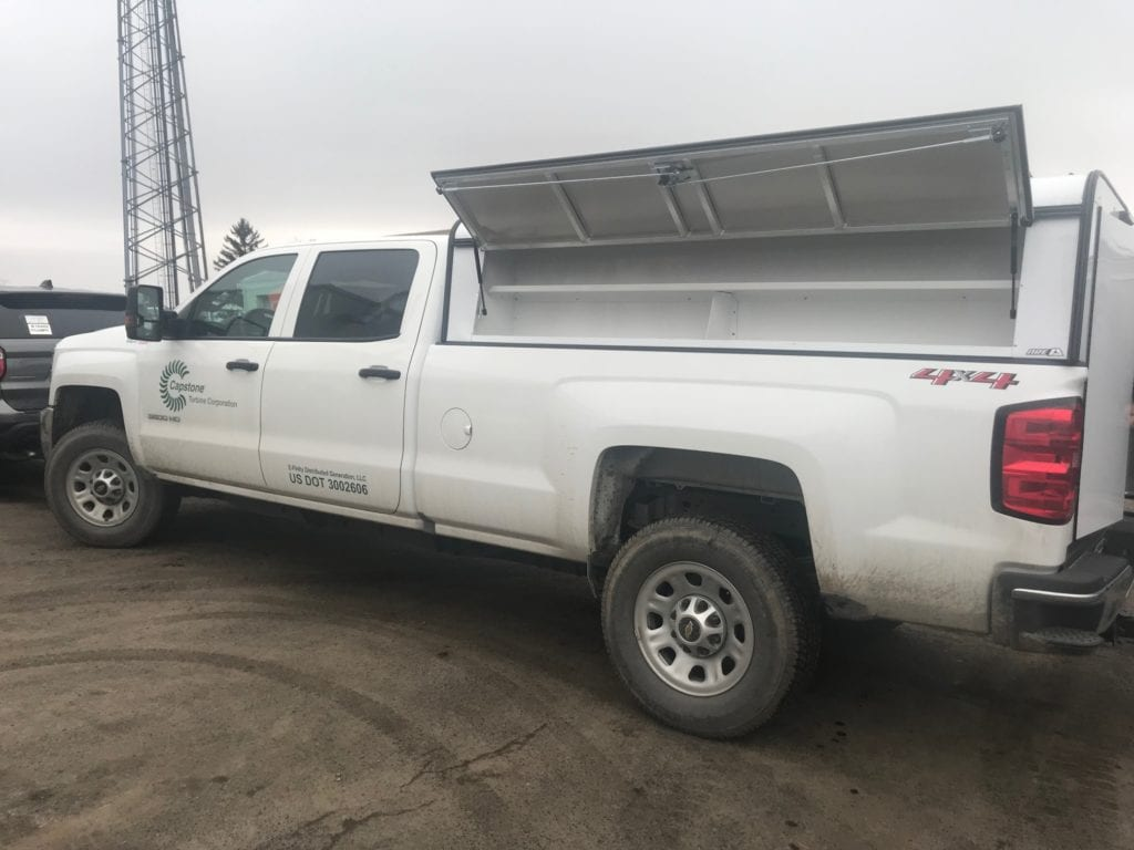 storage on side of white pickup truck