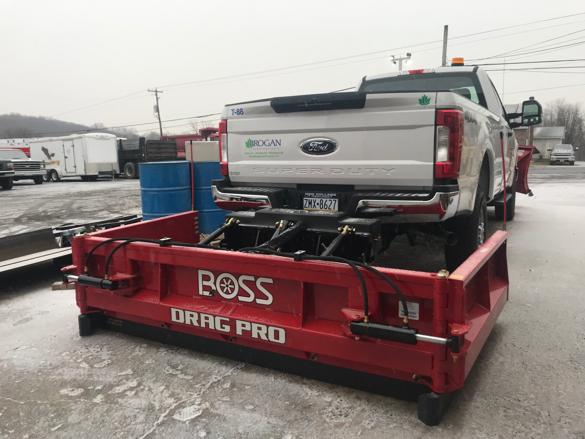 back of white pickup with red drag pro