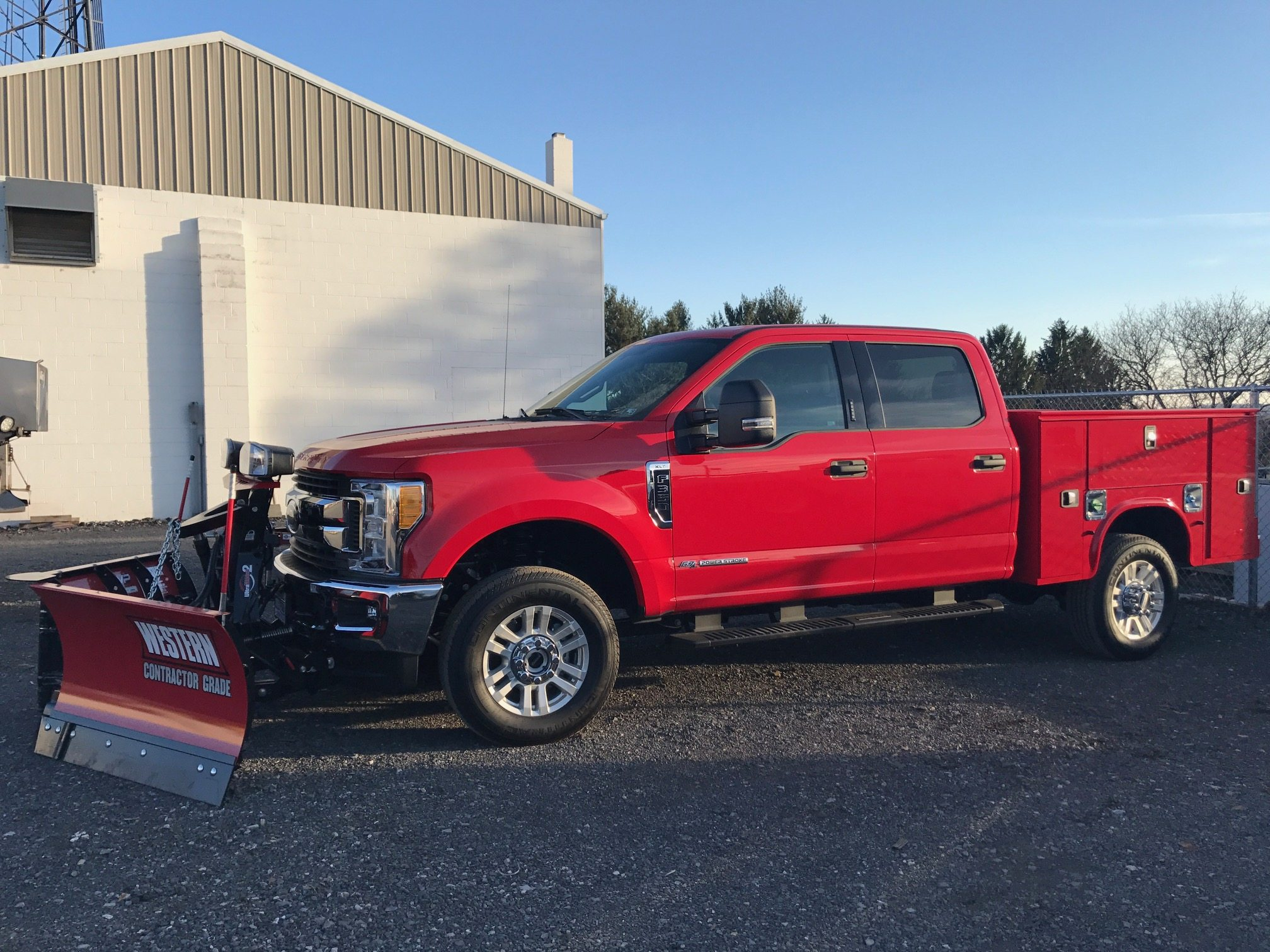 Red truck with plow