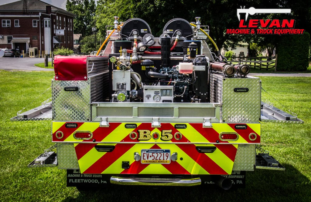 back of fire truck parked on grass