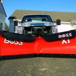 Dual Boss brand snowplows on truck
