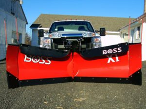 Dual Boss brand snowplows on truck