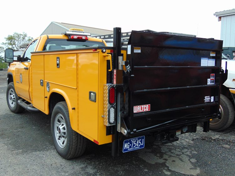 Yellow truck with black liftgate